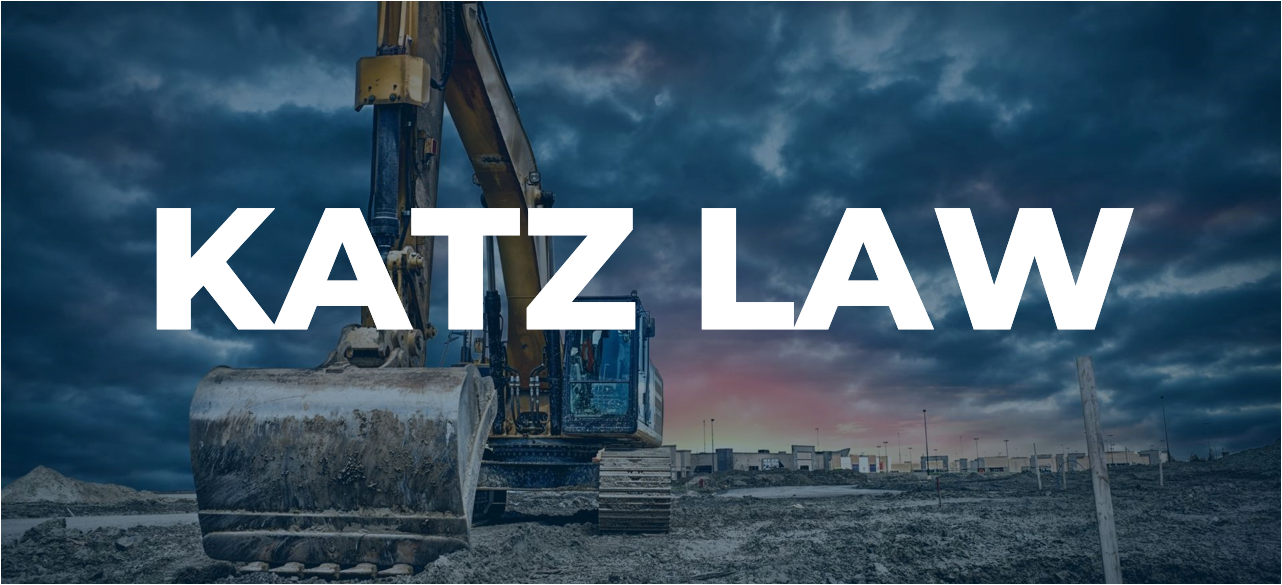 """A photo of an excavator with text that reads """"Maryland and Washington DC Construction Lawyer"""""""